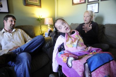 Randy Smith and Deedee Smith talk about raising a child with disabilities while Gracelynn, 5, sits in her wheelchair during an interview in their home Monday, November 19, 2012 in Athens, Ala. (Eric Schultz / eschultz@al.com)