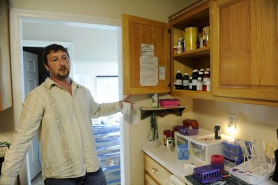 Randy Smith shows a medicine cabinet filled with Gracelynn Smith's daily medications during an interview in their home Monday, November 19, 2012 in Athens, Ala. (Eric Schultz / eschultz@al.com)
