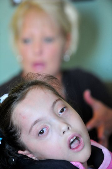 Gracelynn Smith, 5, looks out the window as her mother, Deedee Smith, talks about the difficulties facing Gracelynn during an interview in their home Monday, November 19, 2012 in Athens, Ala. (Eric Schultz / eschultz@al.com)