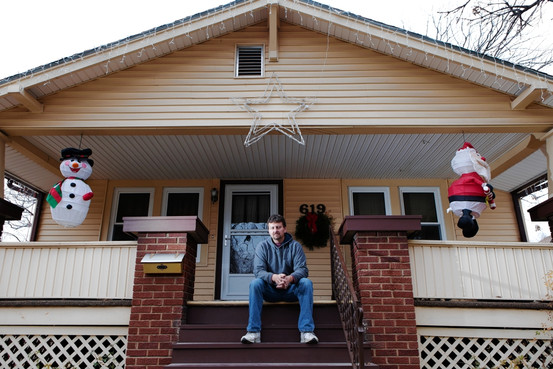 After nearly 22 years at Hostess, former forklift operator Craig Davis is pondering his future on the front porch of his home in Emporia, Kansas. Ryan Nicholson for The Wall Street Journal