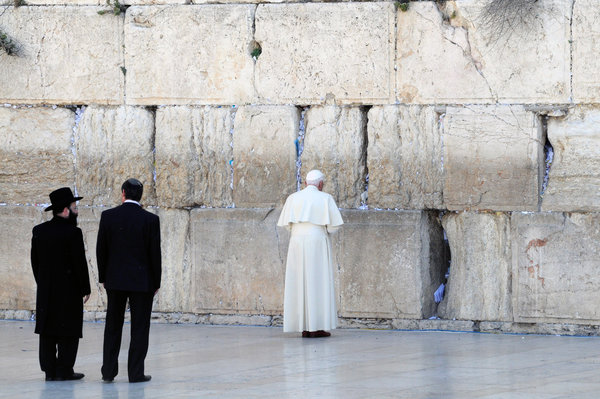 Pope Benedict XVI at the Western Wall, Judaism's holiest prayer site, in May 2009. - Pool photo by Debbie Hill