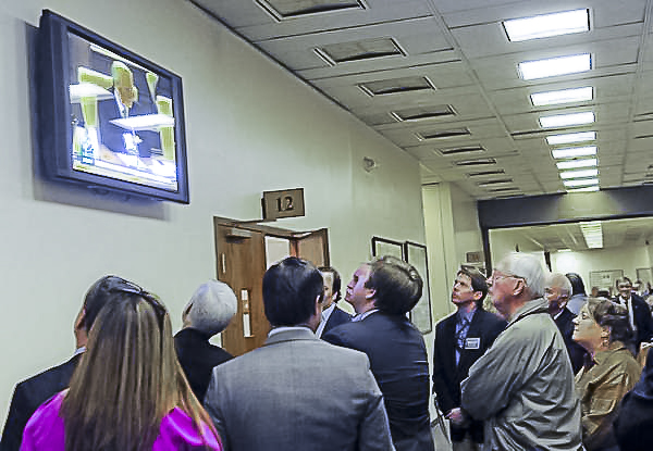 A crowd stands in the hallway to listen to state Sen. Bill Ketron speak about wine-in-supermarkets legislation on Monday at Legislative Plaza in Nashville. Samuel M. Simpkins / The Tennessean