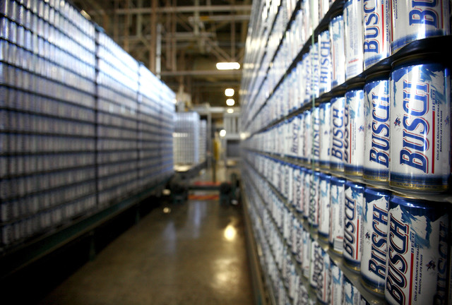 Beer drinkers have filed at least eight lawsuits accusing Anheuser-Busch InBev NV's St. Louis-based Anheuser-Busch Cos. of adding water to several products. - Ken James/Bloomberg