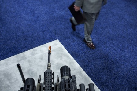 A man walks past a QinetiQ Group Plc modular advanced armed robotic system at the Association for Unmanned Vehicle Systems International's North America 2011 exhibition in Washington, D.C. Photographer: Brendan Smialowski/Bloomberg