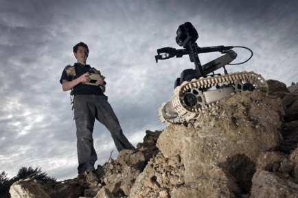 A QinetiQ Group PLC operator controls a Dragon Runner robot. The People's Liberation Army unveiled a bomb disposal robot in April 2012 similar to QinetiQ's Dragon Runner. / QinetiQ Group PLC via Bloomberg