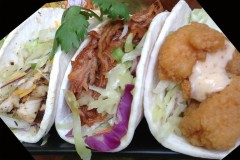 CafŽ Caribe's Taco Slider Trio -- A sampler of 3 bite-size tacos: grilled jerk chicken with cheese; pulled pork smothered in a tangy BBQ sauce; and crunchy shrimp topped with creamy chipotle sauce. All are garnished with citrus slaw. Available at CafŽ Caribe, located on Carnes Ave., near Chambers St. (Photo courtesy of the Minnesota State Fair.)