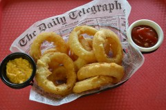 Craft Beer Battered Onion Rings -- Thick-cut onions are dipped in Indeed Daytripper, a local craft beer, then battered, deep fried and served with a spicy beer mustard. Available at Ball Park Café, located on Underwood St., near Carnes Ave. (Photo courtesy of the Minnesota State Fair.)