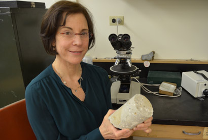 Marie Jackson holds a 2,000-year-old sample of maritime concrete from the first century B.C. Santa Liberata harbor site in Tuscany. (Sarah Yang photo)