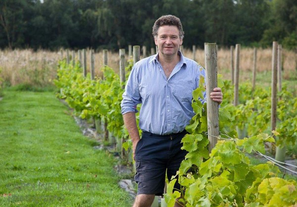 Chris Trotter, Scottish Chef & Vintner, stands in his vineyard