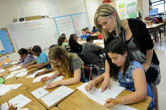 A fifth-grade teacher helps students at Silver Lake Elementary School in Middletown, Delaware (AP Photo/Steve Ruark) Photo **FILE**