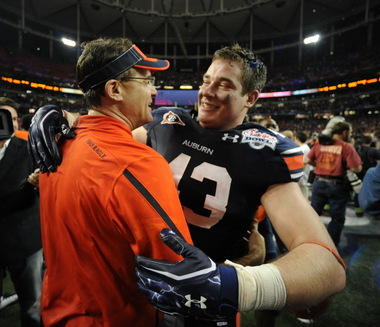Auburn tight end Philip Lutzenkirchen hugs Auburn Gus Malzahn after the game as Auburn defeats Virginia 43-24 in the Chick-Fil-A Bowl at the Georgia Dome Saturday December 31, 2011 in Atlanta, GA (Birmingham News, Hal Yeager)