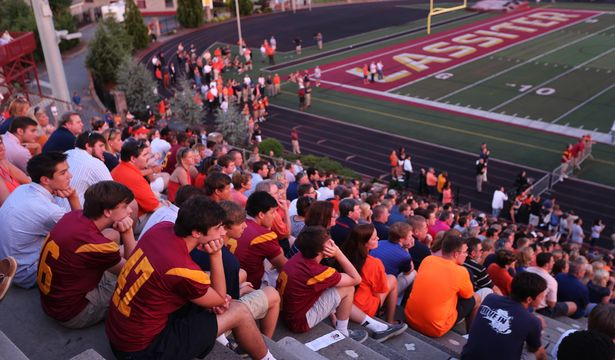 Friends, family, teammates and fans listen to remembrances about Philip Lutzenkirchen during a memorial service at Lassiter High School in east Cobb on Wednesday evening July 2, 2014. Lutzenkirchen was a star football player at Lassiter and Auburn who died in a car accident.