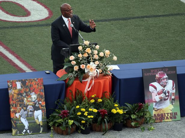 The Rev. Chette Williams, Auburn University Athletics Chaplain, remembers Philip Lutzenkirchen during a memorial service at Lassiter High School in east Cobb on Wednesday evening July 2, 2014. Lutzenkirchen was a star football player at Lassiter and Auburn who died in a car accident.