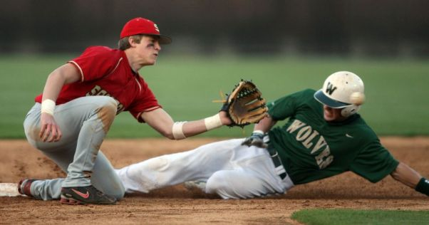 Wesleyan's Ian Davis (5) steals second base in a game vs. Greater Atlanta Christian School on March 25, 2008, in Norcross. (Jason Getz / AJC) Davis was the driver of a vehicle in a multiple-fatality crash in the early morning hours of June 29, 2014. The vehicle failed to stop at a stop sign and traveled approximately 451 feet before overturning several times in a church yard, according to Georgia State Patrol. Davis and former Auburn Tigers tight end Philip Lutzenkirchen died in the crash. Photo by Jason Getz