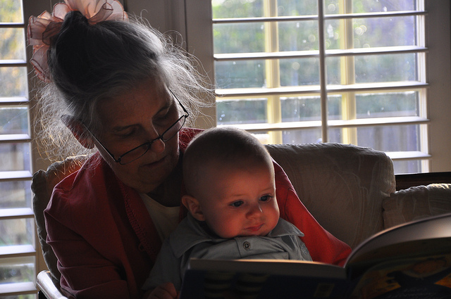 Grandmother S reads to Baby Christian Easter Sunday, 2010