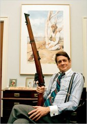 Representative Charlie Wilson in 1988, holding a British-made Enfield rifle in his Capitol Hill office. Credit Marcy Nighswander/Associated Press