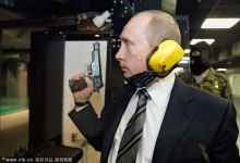 Russian President Vladimir Putin shoots a handgun on the firing range at a new headquarters of the Main Intelligence Agency (GRU) of the Russian Armed Forces General Staff on November 8, 2006.