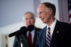 Republican Alabama Governor Robert Bentley (foreground, RIGHT), and Attorney General Luther Strange. Both men were re-elected to their positions in 2010.
